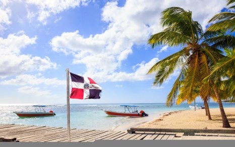 dominican-republic-flag-and-caribbean-beach